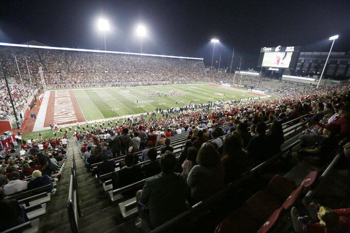 Fans watch the first half of an NCAA college football game between Washington State and Utah State, Saturday, Sept. 4, 2021, at Martin Stadium in Pullman, Wash. (AP Photo/Young Kwak)