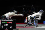 France's Maxime Valket, left, and Greece's Panagiotis Triantafyllou compete for a bronze medal in men's sabre individual category B at the Tokyo 2020 Paralympic Games, Wednesday, Aug. 25, 2021, in Chiba, Japan. Each athlete has unique differences that have to be classified according to individual impairments. (AP Photo/Kiichiro Sato)