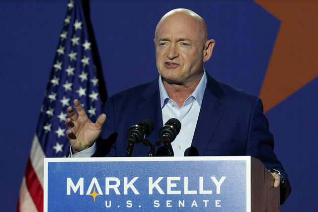 Mark Kelly, Arizona Democratic candidate for U.S. Senate, speaks at an election night event Tuesday, Nov. 3, 2020 in Tucson, Ariz. (AP Photo/Ross D. Franklin)