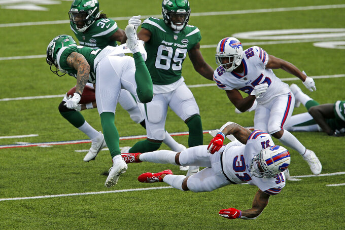 New York Jets safety Ashtyn Davis (32) is upended while returning a kick off by Buffalo Bills strong safety Dean Marlowe (31) during the second half of an NFL football game in Orchard Park, N.Y., Sunday, Sept. 13, 2020. The Bills won 27-17. (AP Photo/John Munson)
