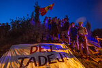 Supporters of Slovene cyclist Tadej Pogacar celebrate his victory at the Tour De France in his hometown of Komenda, central Slovenia, Saturday, Sept. 19, 2020. In an incredible climax to the Tour de France, Tadej Pogacar crushed his fellow Slovenian, Primoz Roglic, in the last stage before the finish in Paris. (AP Photo/Darko Bandic)
