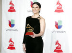 Laura Pausini poses in the press room with the award for best traditional pop vocal album for