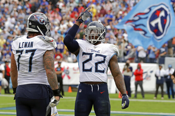 Tennessee Titans running back Derrick Henry (22) celebrates with offensive tackle Taylor Lewan (77) after Henry scored a touchdown against the Buffalo Bills in the second half of an NFL football game Sunday, Oct. 6, 2019, in Nashville, Tenn. (AP Photo/James Kenney)
