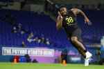 Mississippi State offensive lineman Tyre Phillips runs a drill at the NFL football scouting combine in Indianapolis, Friday, Feb. 28, 2020. (AP Photo/Michael Conroy)