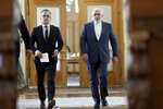 Iranian Foreign Minister Mohammad Javad Zarif, right, and his German counterpart Heiko Maas walk to a press conference after their talks, in Tehran, Iran, Monday, June 10, 2019. Iran's foreign minister warned the U.S. on Monday that it