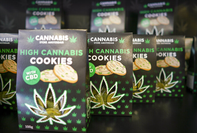 In this Thursday, June 6, 2019 photo, boxes of cookies are on sale at a Cannabis light store in Rome. It's been called Italy's ''Green Gold Rush,'' a flourishing business around light marijuana that has created 15,000 jobs and an estimated 150 million euros worth of annual revenues in under three years.  But the budding sector is facing a political and judicial buzzkill. (AP Photo/Andrew Medichini)