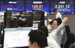 A currency trader stretches at the foreign exchange dealing room of the KEB Hana Bank headquarters in Seoul, South Korea, Thursday, April 18, 2019. Asian stocks fell Thursday after Wall Street declined despite encouraging Chinese economic data. (AP Photo/Ahn Young-joon)
