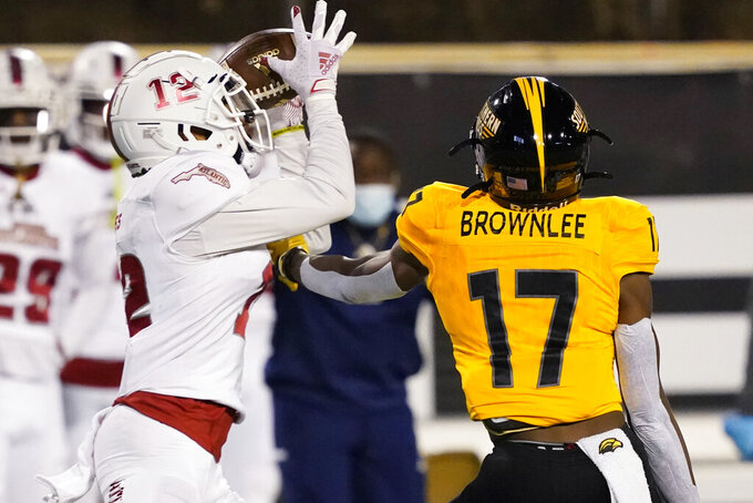 Florida Atlantic cornerback Diashun Moss (12) catches a tipped pass intended for Southern Mississippi wide receiver Jason Brownlee (17) for an interception during the first half of an NCAA college football game Thursday, Dec. 10, 2020, in Hattiesburg, Miss. (AP Photo/Rogelio V. Solis)