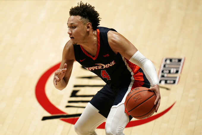 Pepperdine guard Colbey Ross dribbles the ball during the second half of the team's NCAA college basketball game against UCLA, Friday, Nov. 27, 2020, in San Diego. (AP Photo/Gregory Bull)