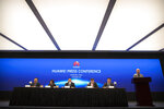 Song Liuping, third from left, chief legal officer of Huawei, speaks during a press conference at Huawei's campus in Shenzhen in southern China's Guandong Province, Thursday, Dec. 5, 2019. Chinese tech giant Huawei is asking a U.S. federal court to throw out a rule that bars rural phone carriers from using government money to purchase its equipment on security grounds. (AP Photo/Mark Schiefelbein)