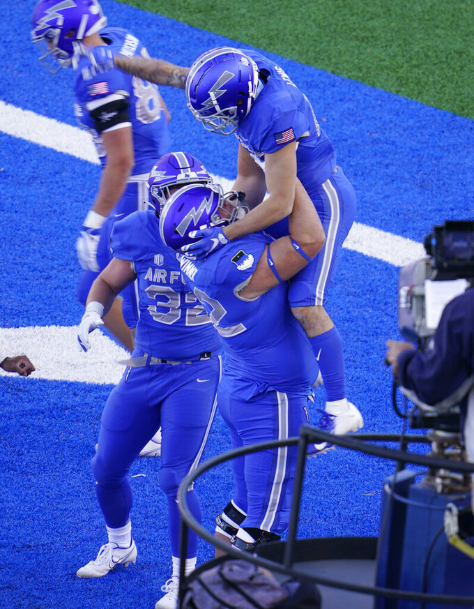 Air Force wide receiver Brandon Lewis, top, celebrates his run for a touchdown with guard Hawk Wimmer in the first half of an NCAA college football game against Boise State, Saturday Oct. 31, 2020, at Air Force Academy, Colo. (AP Photo/David Zalubowski)