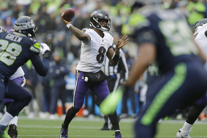 Baltimore Ravens quarterback Lamar Jackson (8) passes against the Seattle Seahawks during the first half of an NFL football game, Sunday, Oct. 20, 2019, in Seattle. (AP Photo/John Froschauer)