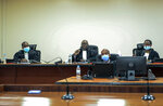 """Judges Antoine Muhima, center, Beatrice Mukamurenzi, right, and Eugene Ndagijimana, left, deliver the ruling in the case of Paul Rusesabagina at a court in Kigali, Rwanda Monday, Sept. 20, 2021. The man who inspired the film """"Hotel Rwanda"""" has been convicted of terrorism offenses and sentenced to 25 years in prison in a trial that human rights watchdogs and other critics of Rwanda's repressive government have described as an act of retaliation. (AP Photo/Muhizi Olivier)"""