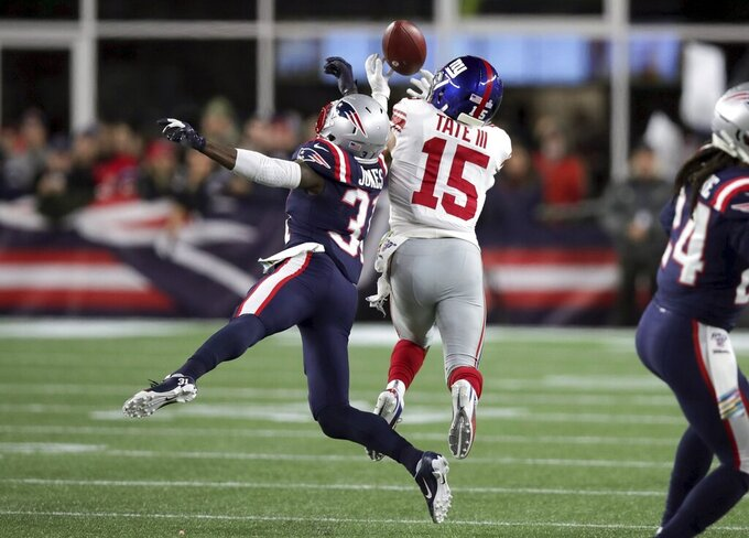 New York Giants wide receiver Golden Tate, right, catches a touchdown pass under pressure from New England Patriots defensive back Jonathan Jones in the first half of an NFL football game, Thursday, Oct. 10, 2019, in Foxborough, Mass. (AP Photo/Charles Krupa)