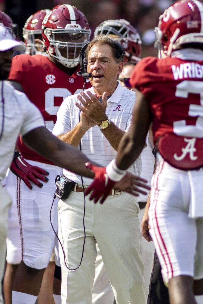 Alabama head coach Nick Saban cheers his team during the first half of an NCAA college football game against Mercer, Saturday, Sept. 11, 2021, in Tuscaloosa, Ala. (AP Photo/Vasha Hunt)