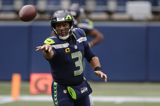 Seattle Seahawks quarterback Russell Wilson warms up before an NFL football game against the New York Giants, Sunday, Dec. 6, 2020, in Seattle. (AP Photo/Larry Maurer)