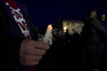 A person holds a candle during a protest over the fatal shooting of Daunte Wright by a police officer, near the Brooklyn Center Police Department, Saturday, April 17, 2021, in Brooklyn Center, Minn. (AP Photo/Julio Cortez)