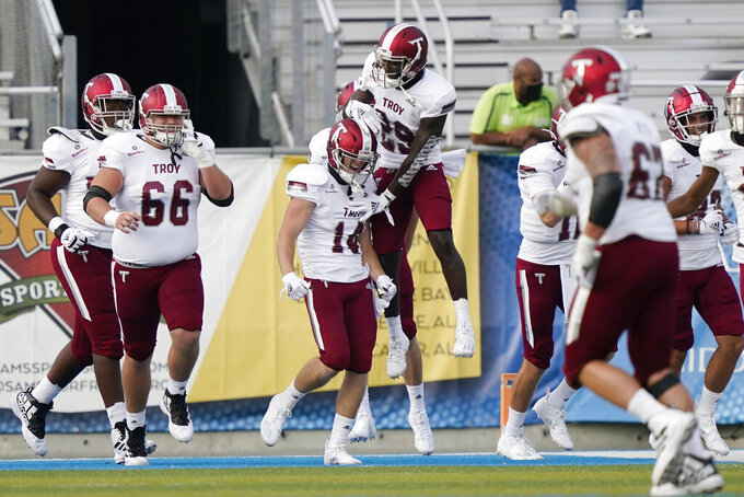 Troy wide receiver Tyler Hussey (14) is congratulated after scoring a touchdown against Middle Tennessee in the second half of an NCAA college football game Saturday, Sept. 19, 2020, in Murfreesboro, Tenn. Troy won 47-14. (AP Photo/Mark Humphrey)