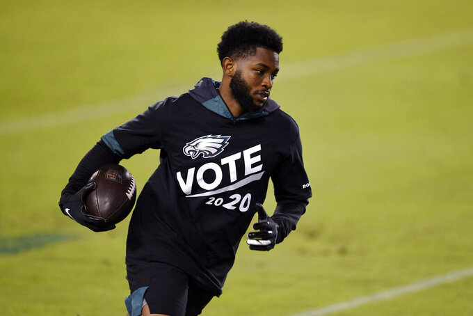 Philadelphia Eagles' Greg Ward warms up before an NFL football game against the Dallas Cowboys, Sunday, Nov. 1, 2020, in Philadelphia. (AP Photo/Derik Hamilton)
