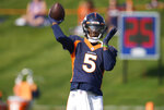 Denver Broncos quarterback Teddy Bridgewater looks to pass the ball while taking part in drills during an NFL football training camp at the team's headquarters Wednesday, Aug. 18, 2021, in Englewood, Colo. (AP Photo/David Zalubowski)