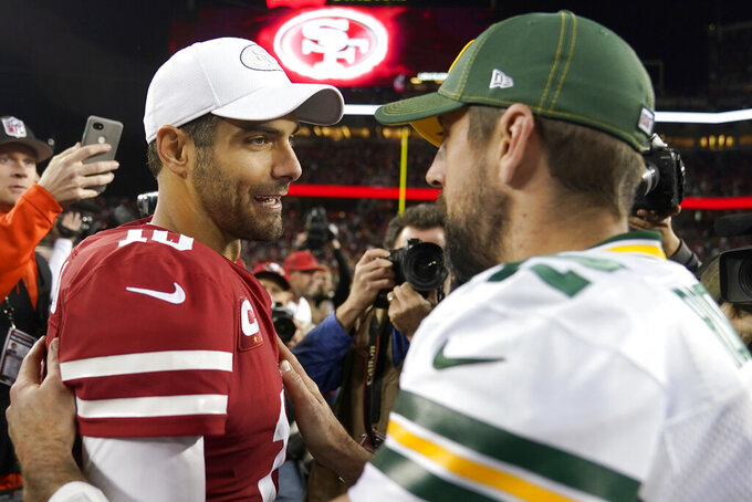 San Francisco 49ers quarterback Jimmy Garoppolo, left, greets Green Bay Packers quarterback Aaron Rodgers after an NFL football game in Santa Clara, Calif., Sunday, Nov. 24, 2019. (AP Photo/Tony Avelar)