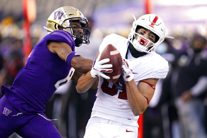 Stanford wide receiver Brycen Tremayne, right, catches a 33-yard pass as Washington defensive back Keith Taylor defends in the second half of an NCAA college football game Saturday, Dec. 5, 2020, in Seattle. (AP Photo/Elaine Thompson)