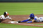 Toronto Blue Jays' Lourdes Gurriel Jr., right, is tagged out by Baltimore Orioles third baseman Rio Ruiz while trying to advance from first on a single by Vladimir Guerrero Jr. during the third inning of a baseball game, Tuesday, Sept. 17, 2019, in Baltimore. (AP Photo/Julio Cortez)