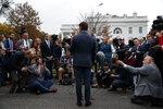 White House deputy press secretary Hogan Gidley talks with reporters outside the White House, Tuesday, Oct. 22, 2019, in Washington. (AP Photo/Evan Vucci)