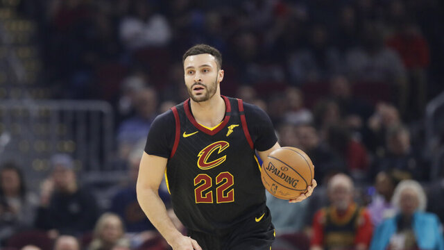 """In this Feb. 12, 2020 photo Cleveland Cavaliers' Larry Nance Jr. drives against the Atlanta Hawks in the first half of an NBA basketball game in Cleveland. Nance Jr. couldn't wait to get back on the floor. After being cooped up for nearly two months because of the COVID-19 pandemic, the Cavaliers forward was grateful to work out at the team's facility last week. """"This is the longest I haven't played a game of basketball in my entire life,"""" he said Tuesday, May 12, 2020 on a Zoom conference call. (AP Photo/Tony Dejak)"""