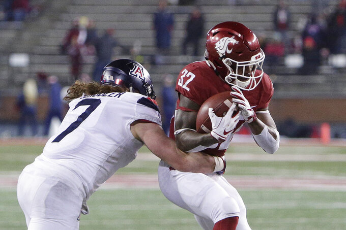 Washington State running back James Williams (32) tries to get away from Arizona linebacker Colin Schooler (7) wraps him up during the second half of an NCAA college football game in Pullman, Wash., Saturday, Nov. 17, 2018. Washington State won 69-28. (AP Photo/Young Kwak)