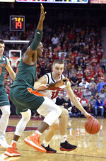 Louisville guard Ryan McMahon (30) attempts to get past the defense of Miami center Ebuka Izundu (15) during the second half of an NCAA college basketball game in Louisville, Ky., Sunday, Jan. 6, 2019. Louisville won 90-73. (AP Photo/Timothy D. Easley)