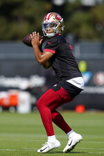 San Francisco 49ers quarterback Trey Lance throws a pass at NFL football training camp in Santa Clara, Calif., Wednesday, July 28, 2021. (AP Photo/Jeff Chiu)
