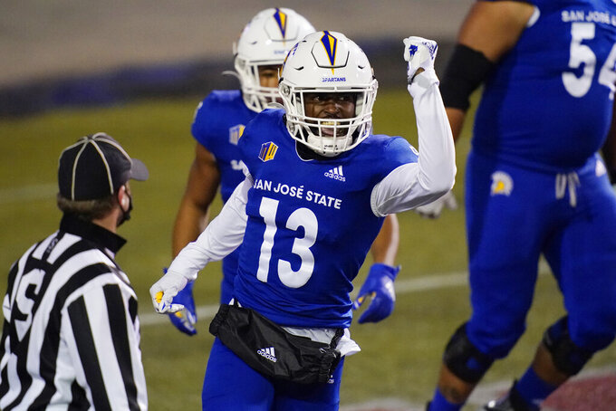 San Jose State wide receiver Jermaine Braddock (13) celebrates after scoring a touchdown against Nevada during the first half of an NCAA college football game Friday, Dec. 11, 2020, in Las Vegas. (AP Photo/John Locher)