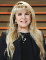 "FILE - Singer Stevie Nicks attends the 2014 Vanity Fair Oscar Party in West Hollywood, Calif., on March 2, 2014. Nicks has spent the last 10 months homebound, mainly due to the coronavirus pandemic. During that time, she recorded the new single ""Show Them the Way"