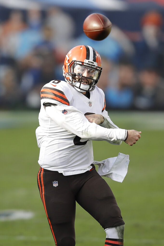 Cleveland Browns quarterback Baker Mayfield (6) passes against the Tennessee Titans in the second half of an NFL football game Sunday, Dec. 6, 2020, in Nashville, Tenn. (AP Photo/Ben Margot)
