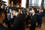 Journalists gather for a press conference that was later postponed ahead of an NBA preseason basketball game on Thursday between the Los Angeles Lakers and Brooklyn Nets in Shanghai, China, Wednesday, Oct. 9, 2019. The NBA has postponed Wednesday's scheduled media sessions in Shanghai for the Brooklyn Nets and Los Angeles Lakers, and it remains unclear if the teams will play in China this week as scheduled. (AP Photo)
