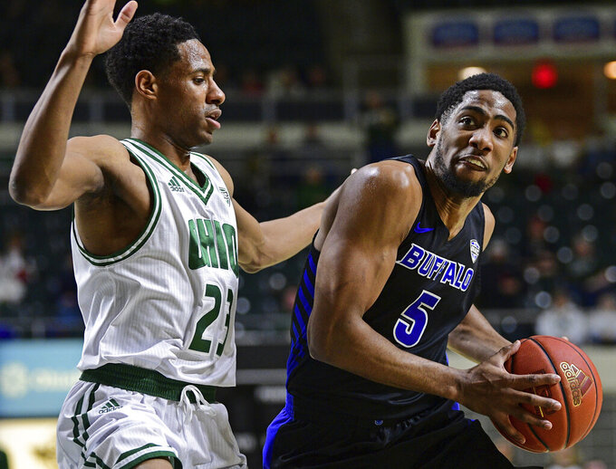 Buffalo guard CJ Massinburg drives on Ohio guard Antonio Cowart Jr. during the first half of an NCAA college basketball game Tuesday, March 5, 2019, in Athens, Ohio. (AP Photo/David Dermer)