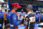 Scott Dixon, of New Zealand, talks with Ed Carpenter after Dixon won the pole for the Indianapolis 500 auto race at Indianapolis Motor Speedway, Sunday, May 23, 2021, in Indianapolis. (AP Photo/Darron Cummings)