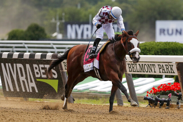 """FILE - In this June 20, 2020, file photo, Tiz the Law, with jockey Manny Franco up, crosses the finish line to win  the Belmont Stakes horse race in Elmont, N.Y. Tiz the Law has been suddenly retired on the advice of a veterinarian after an X-ray revealed bone bruising in the colt's front leg. Jack Knowlton of Sackatoga Stable tweeted Wednesday, Dec. 30, 2020, """"We are beyond grateful for the time we had with him."""" The New York state ownership group had been expecting to race the colt as a 4-year-old next year. (AP Photo/Seth Wenig)"""