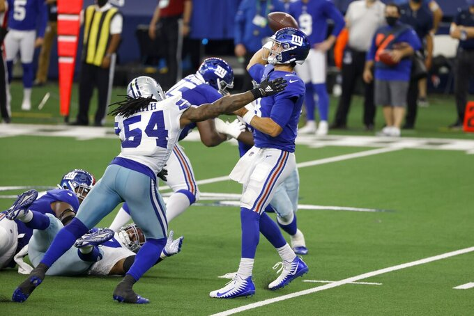 Dallas Cowboys linebacker Jaylon Smith (54) pressures as New York Giants quarterback Daniel Jones (8) throws a pass in the first half of an NFL football game in Arlington, Texas, Sunday, Oct. 11, 2020. (AP Photo/Ron Jenkins)