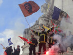 Firemen wave flags atop a statue as they protest with hospital staff on wages, working conditions and pensions, Tuesday, Oct. 15, 2019 in Paris. (AP Photo/Michel Euler)
