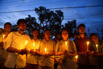 In this Monday, June 11, 2018 photo, supporters of Nilotpal Das, and Abhijit Nath, who were killed by mobs, hold candles during a protest in Gauhati, India. Fueled by rumors of child kidnappers, and spread on social media, mobs have killed well over a dozen Indians in brutal attacks since early May. (AP Photo/Anupam Nath)