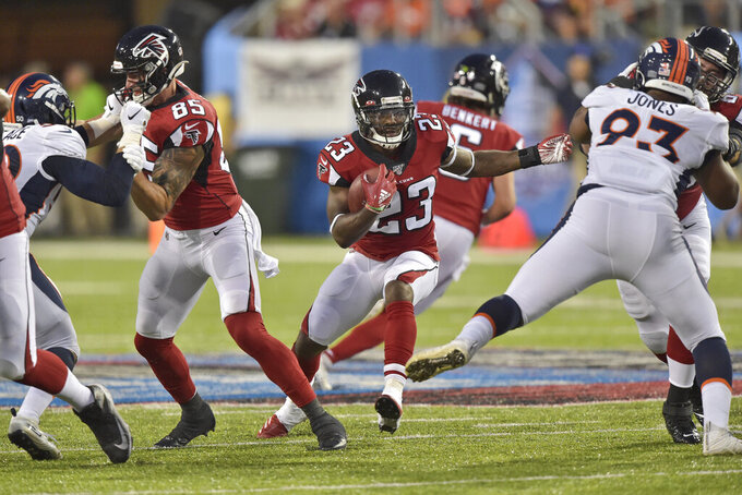 Atlanta Falcons running back Brian Hill rushes during the first half of the team's Pro Football Hall of Fame NFL preseason game against the Denver Broncos, Thursday, Aug. 1, 2019, in Canton, Ohio. (AP Photo/David Richard)
