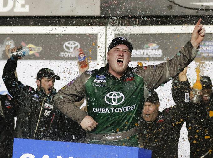 Austin Hill celebrates in Victory Lane after winning a NASCAR Truck Series auto race at Daytona International Speedway, Friday, Feb. 15, 2019, in Daytona Beach, Fla. (AP Photo/John Raoux)