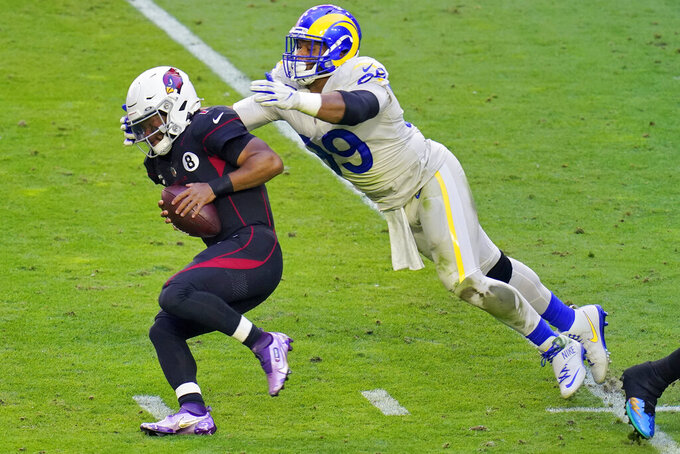 Arizona Cardinals quarterback Kyler Murray (1) is tackled by Los Angeles Rams defensive end Aaron Donald (99) during the first half of an NFL football game, Sunday, Dec. 6, 2020, in Glendale, Ariz. (AP Photo/Ross D. Franklin)