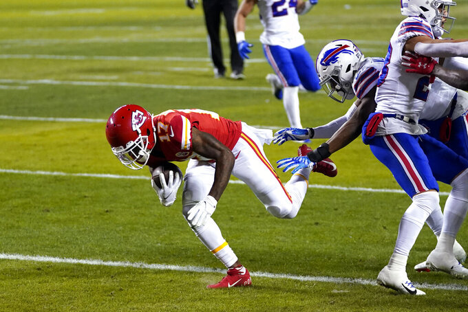 Kansas City Chiefs wide receiver Mecole Hardman, left, catches a 3-yard touchdown pass during the first half of the AFC championship NFL football game against the Buffalo Bills, Sunday, Jan. 24, 2021, in Kansas City, Mo. (AP Photo/Jeff Roberson)