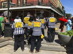 FILE - In this March 5, 2019, file photo, a group of Fat Tuesday parade goers dressed as blind referees show off the signs on their backs, in New Orleans. Referees know going in they'll never get their due. (AP Photo/Rebecca Santanta, File)