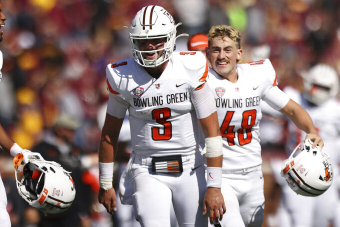 Bowling Green quarterback Matt McDonald (3) smiles in celebration after winning 14-10 against Minnesota during an NCAA college football game Saturday, Sept. 25, 2021, in Minneapolis. (AP Photo/Stacy Bengs)