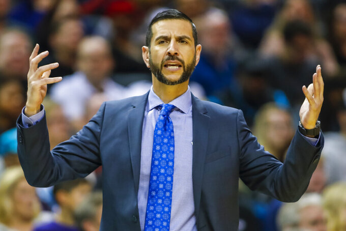 FILE - In this Nov. 23, 2019, file photo, Charlotte Hornets' head coach James Borrego pleads for results during the first half of an NBA basketball game against the Chicago Bulls in Charlotte, N.C. Borrego believes Charlotte could be at a major disadvantage because they won't be playing in Orlando when the NBA returns to action. (AP Photo/Bob Leverone, File)