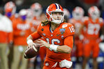 FILE - Clemson quarterback Trevor Lawrence passes against Ohio State during the first half of the Sugar Bowl NCAA college football game in New Orleans, in this Friday, Jan. 1, 2021, file photo. The Jacksonville Jaguars have done just about everything short of announce Lawrence as their first pick in the NFL Draft. (AP Photo/John Bazemore, File)